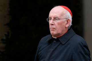 Cardinal Sean Brady of Armagh, Northern Ireland, leaves a meeting of cardinals in the synod hall at the Vatican in this Feb. 20, 2014, file photo. Pope Francis accepted the resignation of Cardinal Brady Sept. 8. Cardinal Brady had served as archbishop of Armagh since 1996 and submitted his resignation upon reaching the reached the mandatory age of 75.