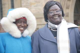 Awak Hussein Deng, youth coordinator for the South Sudan Council of Churches, and Agnes Wasuk Petia, coordinator of the Council's National Women's Program, on Parliament Hill Dec. 7
