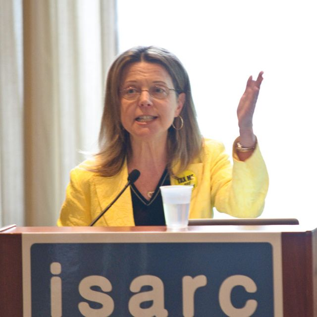 Dr. Rosana Pelizari, Peterborough's Medical Officer of Health, addresses delegates to ISARC's exploration of health and poverty.