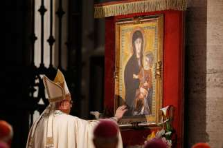 Pope Francis touches a Marian image after leading Benediction outside the Basilica of St. Mary Major on the feast of Corpus Christi in Rome May 26.