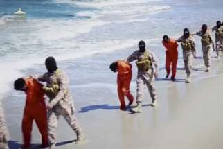 Islamic State militants lead what are said to be Ethiopian Christians along a beach in Libya in this still image from an undated video made available on a social media website April 19.