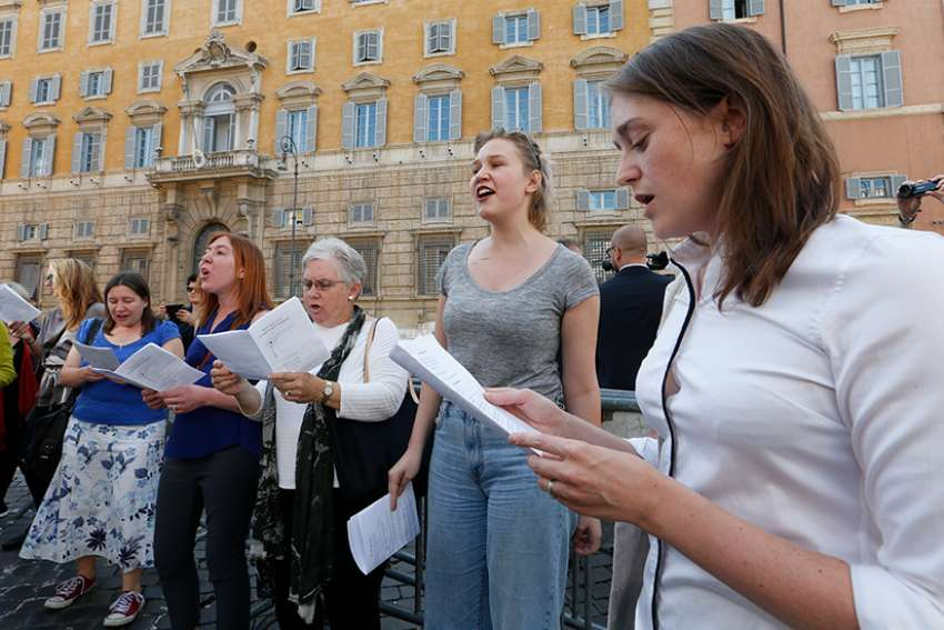Protesters chant outside the Congregation for the Doctrine of the Faith before the opening session of the Synod of Bishops on young people, the faith and vocational discernment at the Vatican Oct 3. Protesters demanded that women be given the right to vote at the synod.