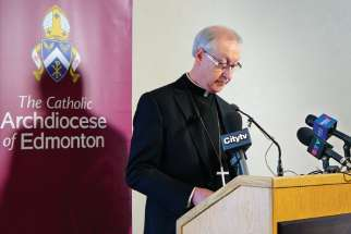 Archbishop Richard Smith speaks to reporters about the updated CCCB abuse prevention guidelines.