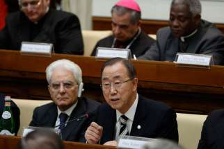 U.N. Secretary-General Ban Ki-moon addresses an April 28 summit on the moral dimensions of climate change and its impact on the poor. Also pictured is Italy's President Sergio Mattarella, lower left.