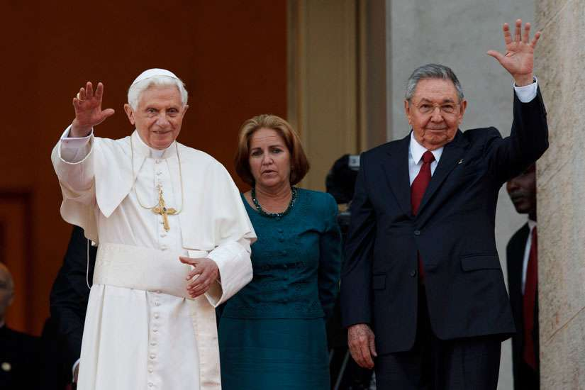Pope Benedict XVI and Cuba's President Raul Castro gesture to the media as they appear for a photo opportunity outside the Palace of the Revolution in Havana March 27, 2012.