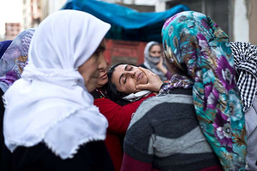 Kurdish women mourn during a funeral ceremony in Sirnak, Turkey, Jan. 10. The U.S. House Foreign Affairs Committee March 2 unanimously passes two bipartisan measures to address war crimes and genocide in Middle East.