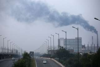 Smoke billows out of factory chimneys Oct. 1 on the outskirts of Delhi, India. Members of the European Parliament voted in favor of the Paris U.N. COP 21 climate change agreement Oct. 4 at a plenary meeting in Strasbourg, France.