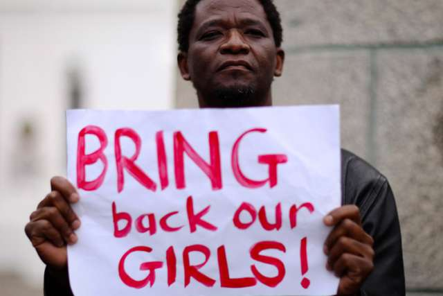 A protester holds a sign during a May 8 march in Cape Town, South Africa, in support of the girls kidnapped in Nigeria. Fr. John Bakeni, secretary of the Roman Catholic Diocese of Maiduguri, expressed doubts about the negotiations between the Nigerian government and the militant group Boko Haram from he release of 200 abducted school girls.