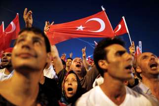 Supporters of Turkish President Tayyip Erdogan celebrate July16 at Taksim Square in Istanbul after a failed coup attempt. Prime Minister Binali Yildirim said more than 200 people were killed during the failed coup attempt.