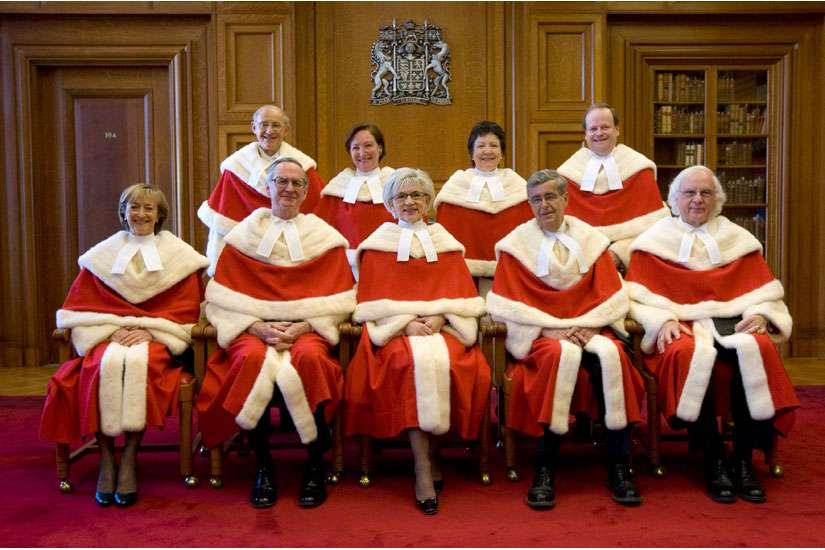Canada's Supreme Court justices pose for a photo at the Supreme Court of Canada in Ottawa Feb. 16. From left, the justices in the front row are: Marie Deschamps, William Ian Corneil Binnie, Chief Justice Beverley McLachlin, Louis LeBel and Morris Fish. Back row: Marshall Rothstein, Rosalie Silberman Abella, Louise Charron and Thomas Cromwell.