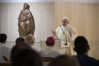 Pope Francis gives the homily as he celebrates morning Mass in the chapel of his residence, the Domus Sanctae Marthae, at the Vatican Nov. 26.