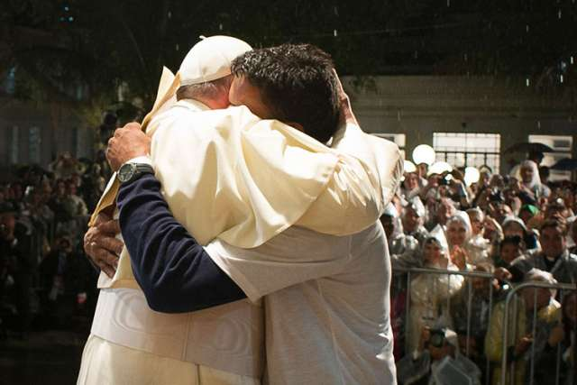 Pope Francis embraces a patient at St. Francis of Assisi Hospital, where the pontiff addressed a group of recovering drug addicts, offering them a message of compassion and hope, in this picture dated July 24, 2014 in Rio de Janeiro.