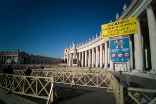 Several visitors enter an empty security queue before visiting St. Peter's Basilica at the Vatican March 4, 2020. Visitors and pilgrims to churches, museums and landmarks in Rome have sharply declined following an outbreak of the COVID-19 coronavirus in northern Italy.