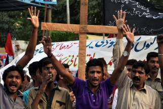 Pakistani members of the Christian minority shout slogans during a Nov. 9 protest in Karachi, Pakistan, against the killing of a Christian couple accused of blasphemy in November 2014.