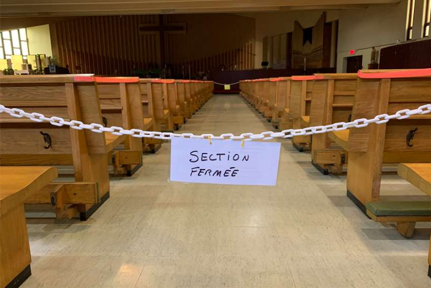 "A sign reads ""closed section"" at St.-Benoît-Abbé's church in Quebec City Oct. 17, 2020, during the COVID-19 pandemic. The Quebec government announced Jan. 6 that places of worship will be completely closed from Jan. 9 to Feb. 8, 2021, during the pandemic."