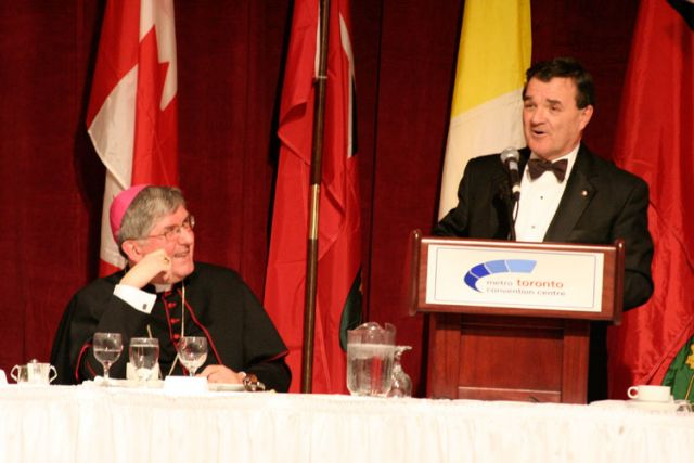 Jim Flaherty, who was then Canada's finance minister, speaks at the annual Cardinal's Dinner in Toronto in 2007 as Cardinal Thomas Collins looks on. Mr. Flaherty died April 10.