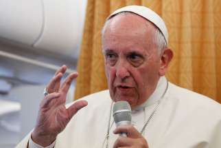 Pope Francis answers questions from journalists aboard his flight from Yerevan, Armenia, to Rome June 26. The Pope said during his in-flight press conference that the church should apologize to gays