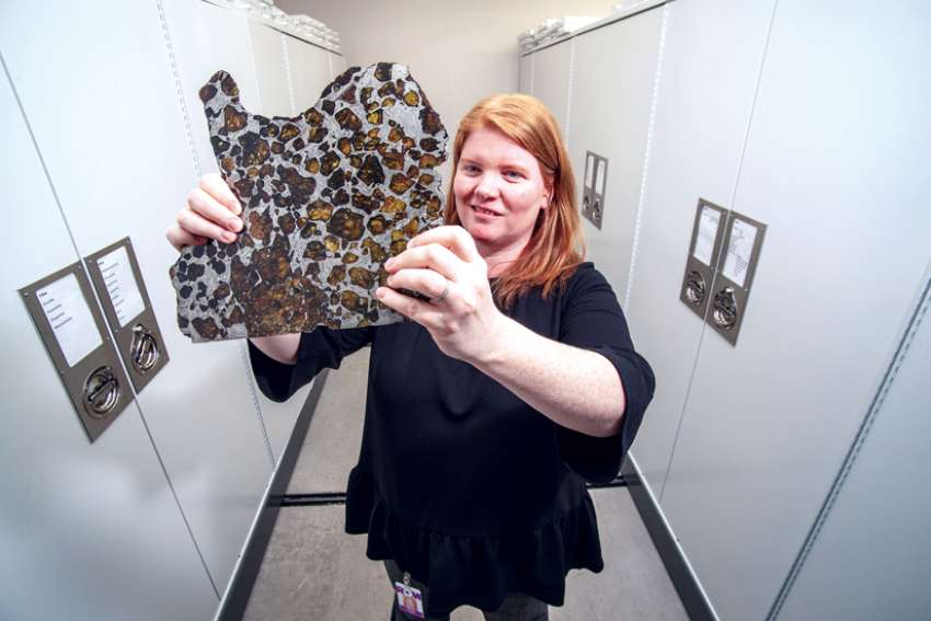 Kim Tait from the Royal Ontario Museum holding a slice of shergottite meteorite.