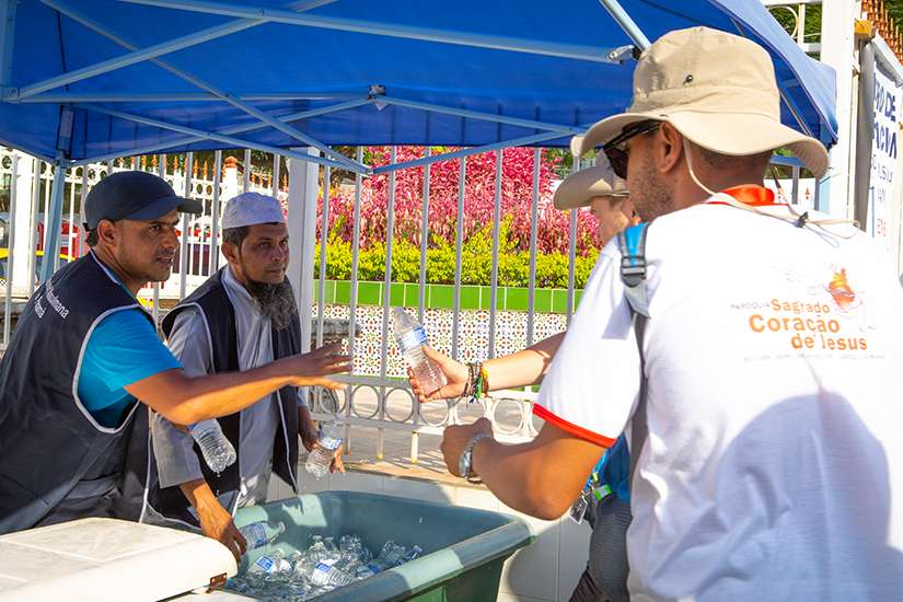 Muslims from Jumma Mosque in Panama City hand out complimentary cold bottles of water to World Youth Day pilgrims waiting to get into a welcoming ceremony with Pope Francis Jan. 24, 2019