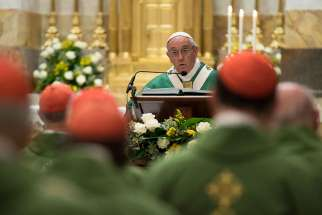 Pope Francis speaks as he celebrates Mass with about 50 cardinals in the Pauline Chapel of the Apostolic Palace at the Vatican June 27. The Mass marked the pope's 25th anniversary of his ordination as a bishop.