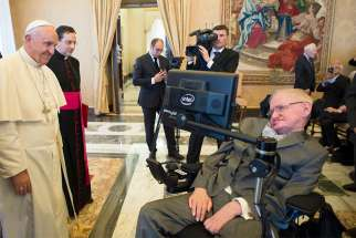 Pope Francis greets Stephen Hawking during an audience with participants attending a plenary session of the Pontifical Academy of Sciences at the Vatican Nov. 28, 2016. Hawking, the British-born theoretical physicist, cosmologist and popular author died March 14 at the age of 76.