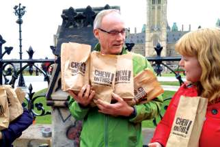 Citizens for Public Justice executive director Joe Gunn, left, seen on Oct. 6 raising awareness of poverty issues in the final week of the federal election campaign. Gunn is pleased an end is coming to special audits of charities
