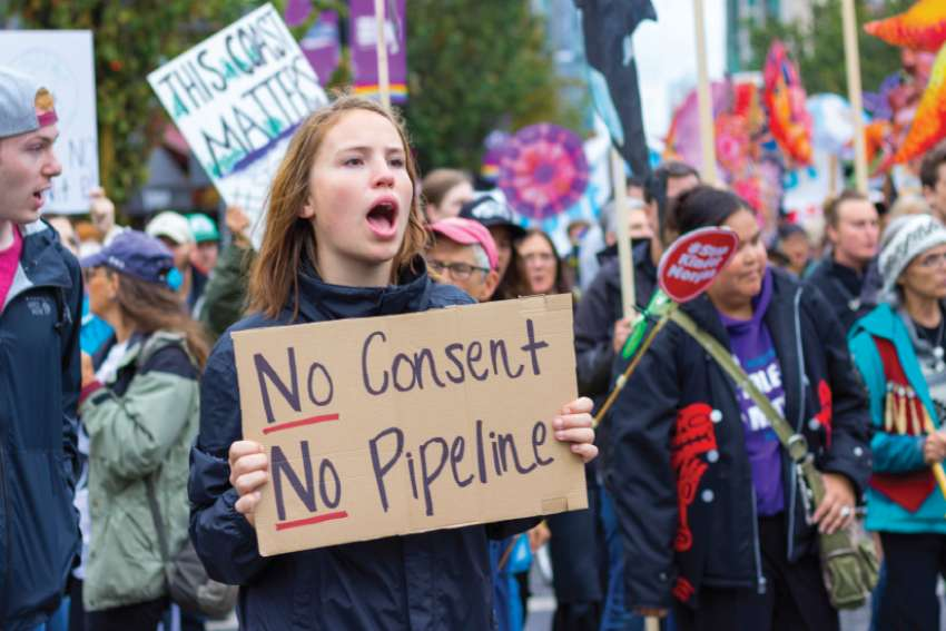 A protester makes her viewpoint known about the proposed Kinder Morgan Trans-Mountain pipeline last fall in Vancouver.