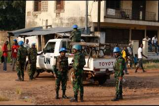 U.N. peacekeepers patrol the street leading