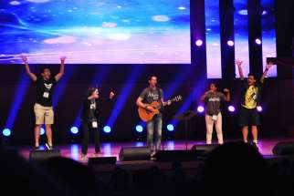 More than 1,600 youth sang and praised God at the Steubenville Toronto conference held at Roy Thomson Hall Aug. 7-9. In this photo, musician Cooper Ray, centre, invited youth on stage to demonstrate dance moves for the crowd to accompany his song.