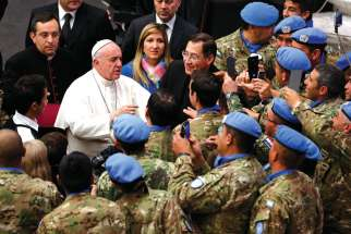 Pope Francis greets UN peacekeepers from Argentina during his general audience in Paul VI hall at the Vatican Dec. 14. In his World Day of Peace message, the Pope calls for a new political order based on peace and non-violence.