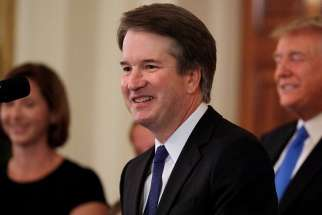 Brett Kavanaugh, a Catholic, who is a judge on the U.S. Court of Appeals for the District of Columbia Circuit, smiles July 9 at the White House in Washington after President Donald Trump named him his Supreme Court nominee.