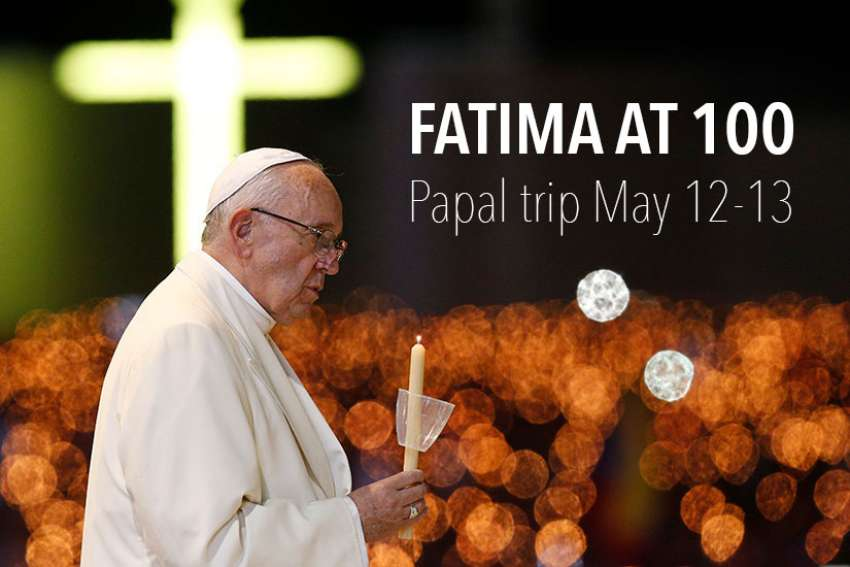 Pope Francis leads the blessing of candles in the Chapel of the Apparitions at the Shrine of Our Lady of Fatima in Portugal, May 12. The Pope was making a two-day visit to Fatima to commemorate the 100th anniversary of the Marian apparitions and to canonize two of the young seers.
