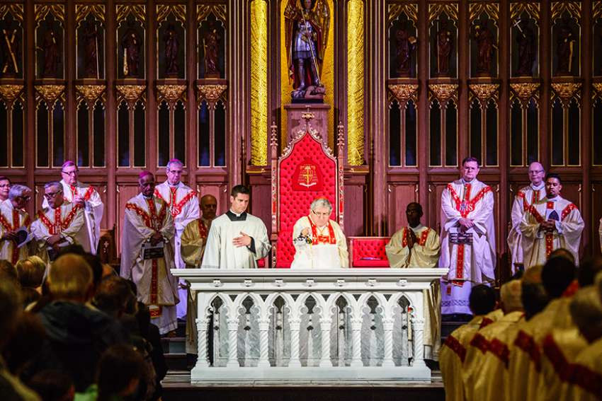 Toronto's Cardinal Thomas Collins anoints the altar of St. Michael's Cathedral during a rededication ceremony Sept. 29, 2016. Canada's proposed Bill C-51 would remove a section of the Criminal Code that currently makes it an indictable offense to threaten or obstruct clergymen or ministers from celebrating services or going about their work.