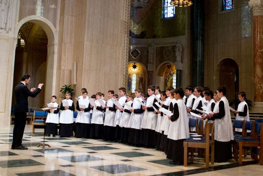 Members of the Escolania de Montserrat, one of the oldest and most venerable boys' choirs in Europe, perform at the Basilica of the National Shrine of the Immaculate Conception in Washington July 2. Founded in the 13th century, the choir sings daily for pilgrims at the abbey of Santa Maria de Monserrat in Catalonia, Spain.