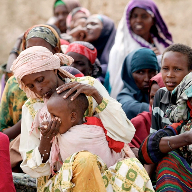 Internally displaced Somali women and children wait at a camp in the capital Mogadishu July 20.