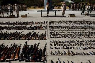 Weapons seized from criminal gangs are displayed before being destroyed by military personnel at a military base in Tijuana, Mexico, on August 12, 2016.