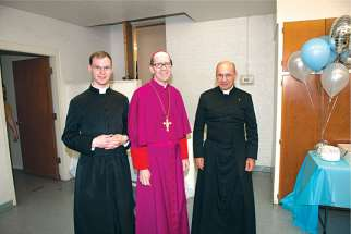 Phoenix Bishop Thomas J. Olsted, centre, is seen with Frs. Kenneth Walker, left, and Joseph Terra, right, in a recent photo. On June 11 the priests were victims of a violent attack. Fr. Walker died of a gunshot wound while Terra is recovering from serious injuries.