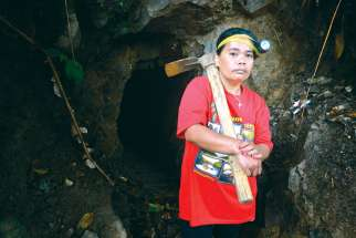 Vicklyn Ebanes, 44, poses outside a small-scale gold mine she operates with her husband in the Diwalwal area on the Philippines' southern island of Mindanao. The Canadian government has objected to a UN resolution to advance rights of indigenous peoples.