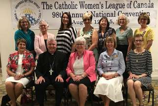 The executive of the Catholic Women's League at the annual national convention in Winnipeg. Outgoing national president Margaret Ann Jacobs is in the centre; on her left is Calgary Bishop William McGrattan, the CWL's spiritual advisor; on his left is past president Barbara Dowding. On Jacobs' right is incoming national president, Anne Gorman.