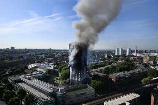 Flames and smoke billow from a London apartment building June 14. London's Metropolitan Police said a number of people were being treated for a range of injuries, and authorities appealed for families to report anyone unaccounted for.