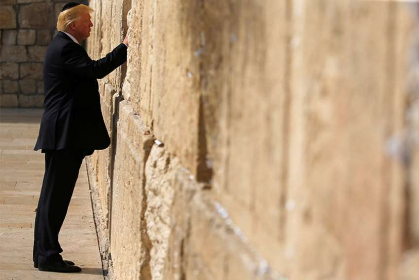 .S. President Donald Trump places a note in the Western Wall in Jerusalem May 22. Following reports that Trump planned to recognize Jerusalem as the capital of Israel, Pope Francis expressed his concern that such a move would further destabilize the Middle East.