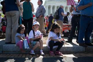 "An immigration rally takes place April 18 outside the U.S. Supreme Court in Washington. The U.S. bishops' migration committee chair in a July 18 statement urged President Donald Trump to ""ensure permanent protection"" for youth under the Deferred Action for Childhood Arrivals program, or DACA."