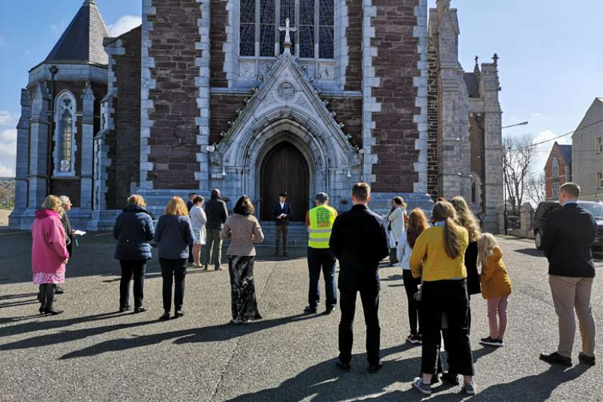 Catholics stand outside Sts. Anne and Mary Cathedral in Cork, Ireland, April 4, 2021, praying that it would be open for Easter Mass during the COVID-19 pandemic. Churches in the Irish Republic have been closed for public worship since Dec. 26, but on April 16, the health minister made it a crime to celebrate or attend a public Mass.