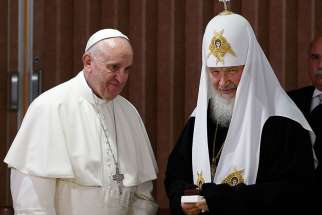 Pope Francis presents gifts to Russian Orthodox Patriarch Kirill of Moscow after the leaders signed a joint declaration during a meeting at Jose Marti International Airport in Havana Feb. 12.