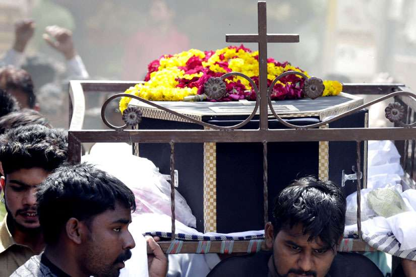 People carry a coffin March 28 after the previous day's suicide bomb attack at a park in Lahore, Pakistan. Observers say the terrorist attack that killed more than 70 people in a Lahore park on Easter was not the first time that Christians in the Islamic country have been targeted.