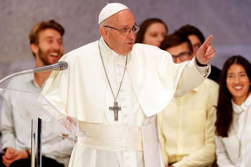 Pope Francis speaks during a gathering with young people and members of the Synod of Bishops at the Vatican Oct. 6.
