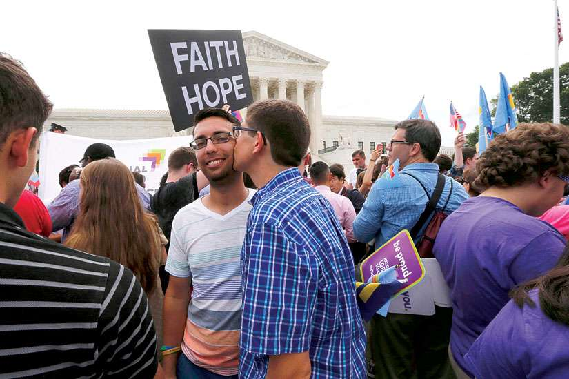 Gay rights supporters celebrate after the U.S. Supreme Court ruled that the U.S. Constitution gives same-sex couples the right to marry.
