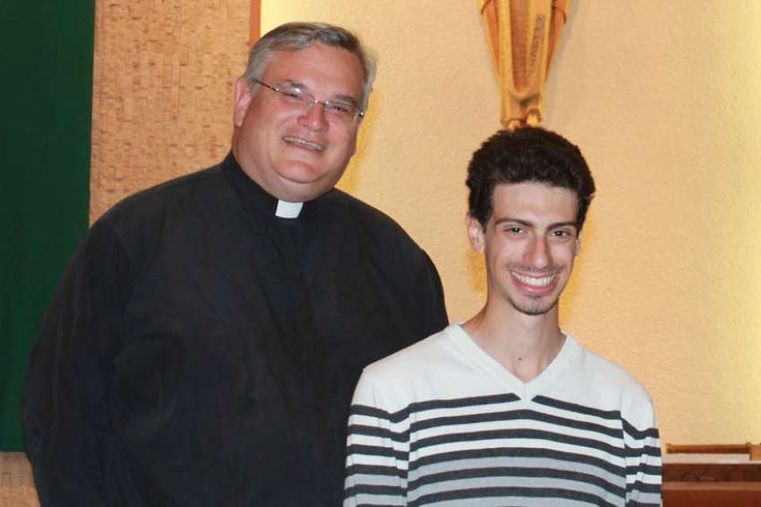 Fr. Larry Léger and youth minister Eric Luscombe are excited to bring new life to Holy Family Parish's youth programs.