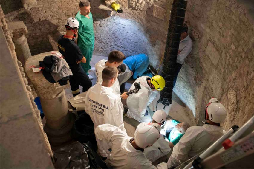 Workers inspect an ossuary at the Teutonic Cemetery at the Vatican July 20, 2019. The ossuary was inspected in the hope of finding the missing remains of a German princess and duchess and possibly the remains of Emanuela Orlandi, who disappeared in 1983. Thousands of bones were found in the ossuary, according to a representative of the Orlandi family who was present for the search.