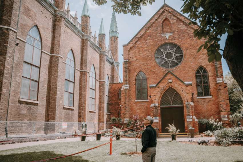 Father Maurice Restivo stands near Our Lady of the Assumption Church in Windsor, Ontario, June 14, 2019. Founded in 1767, the Canadian church needs $20 million dollars in repairs.